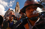 Bolivian miners stand waiting  for the announcement of president Carlos Mesa's resignation near Murillo square, as they try to get close to the Bolivian National Congress in La Paz, Bolivia on Wednesday, May 18, 2005.(Dado Galdieri)