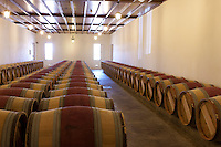barrels in the chais at Chateau Petrus..Photograph by Owen Franken.