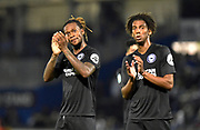 Gaetan Bong (3) of Brighton and Hove Albion and Bernardo De Silva (30) of Brighton and Hove Albion applauds, claps the travelling fans at full time after a 2-1 win over Bristol Rovers during the EFL Cup match between Bristol Rovers and Brighton and Hove Albion at the Memorial Stadium, Bristol, England on 27 August 2019.