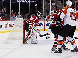 Oct 3, 2009; Newark, NJ, USA; Philadelphia Flyers center Jeff Carter (17) puts a shot by New Jersey Devils goalie Martin Brodeur (30) during the first period at the Prudential Center.