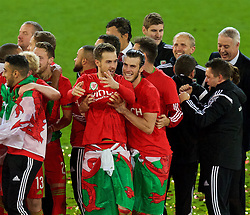 CARDIFF, WALES - Tuesday, October 13, 2015: Wales' Aaron Ramsey and Gareth Bale celebrate after qualifying for the finals following a 2-0 victory over Andorra during the UEFA Euro 2016 qualifying Group B match at the Cardiff City Stadium. (Pic by Paul Currie/Propaganda)