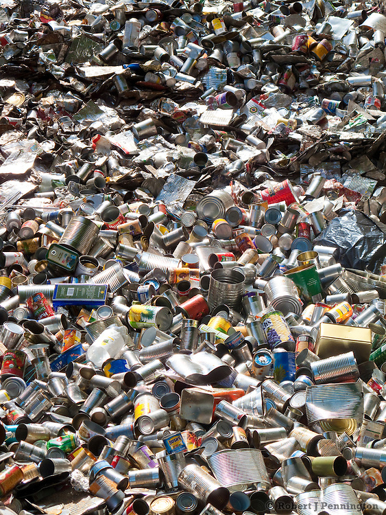 Waste material is sorted and compressed in preparation of recycling.