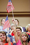 Aug 26, 2009 -- PHOENIX, AZ: KELLY DESPAIN (left) and SARAH CRAWFORD, both from Gilbert, AZ, wave American flags at North Phoenix Baptist Church in Phoenix, AZ, Wednesday. They are supporters of Sen John McCain. Sen McCain hosted his second town hall meeting on health care in two days Wednesday. About 1,000 people attended the meeting. Although most were opposed to President Obama's health care proposals and supported Sen McCain, there was a large group who support the President's health care efforts.  Photo by Jack Kurtz