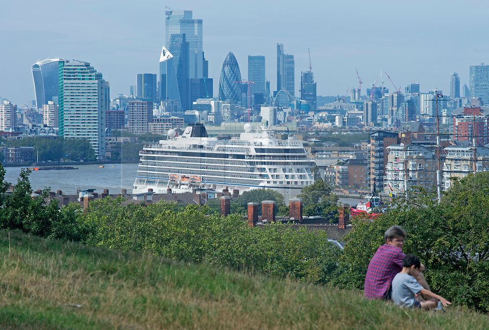 ©Licensed to London News Pictures 30/08/2019.<br /> Greenwich ,UK. The Viking Sun cruise ship from Norway is pulled backwards down the River Thames this afternoon so it can dock next to the Cutty Sark in Greenwich, London.  Photo credit: Grant Falvey/LNP