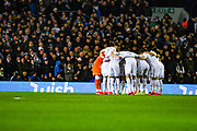 Leeds United players huddle during the EFL Sky Bet Championship match between Leeds United and Millwall at Elland Road, Leeds, England on 28 January 2020.