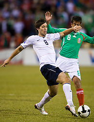 United States forward Clint Dempsey (8) challenges Mexico midfielder Pavel Pardo (8) for possession.  The United States men's soccer team defeated the Mexican national team 2-0 in CONCACAF final group qualifying for the 2010 World Cup at Columbus Crew Stadium in Columbus, Ohio on February 11, 2009.