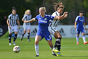Chelsea Ladies defender Gilly Flaherty and Notts County Ladies forward Jess Clarke tussle for the ball during the FA Women's Super League match between Chelsea Ladies FC and Notts County Ladies FC at Staines Town FC, Staines, United Kingdom on 6 September 2015. Photo by Mark Davies.