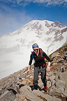 A young woman hiking the Skyline Trail on Mount Rainier, Washington, USA.