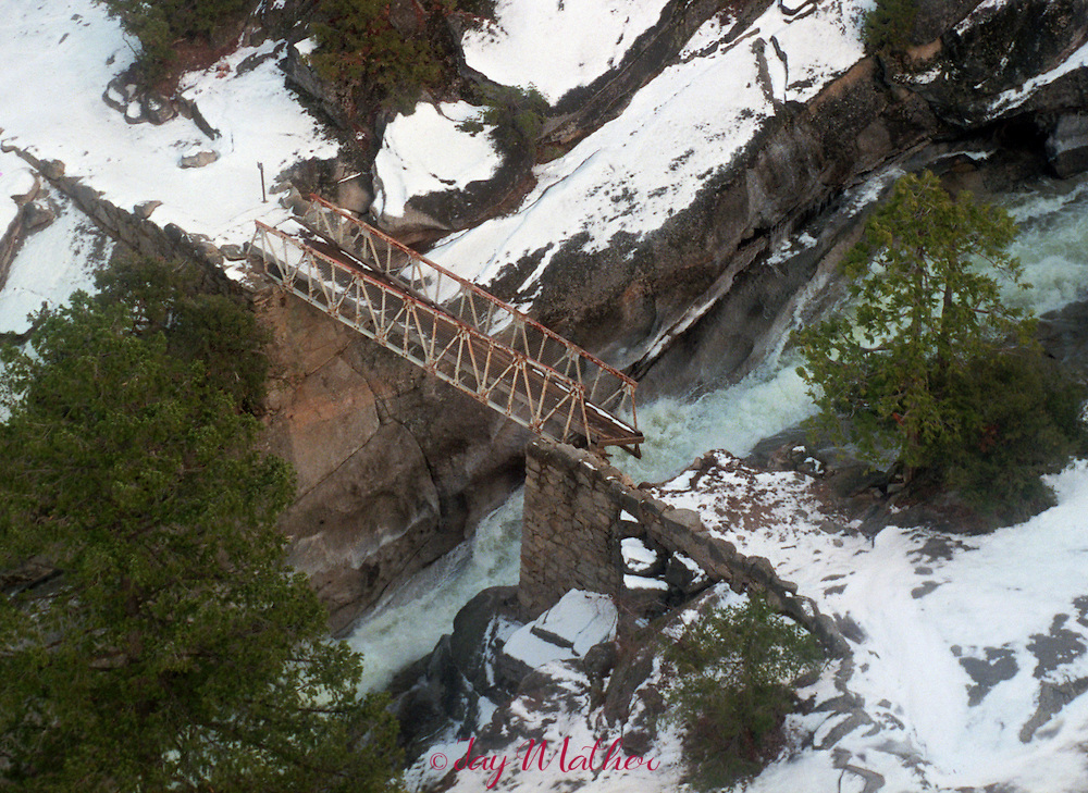 In the back country of Yosemite National Park many bridges were damaged or simply washed away during the January 2, 1997 flooding in the Park's rivers.  The flooding on the Merced River nearly destroyed this bridge on the Muir Trail between Vernal and Nevada Falls.