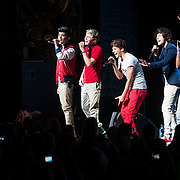 May 26, 2012 - New York, NY : Pop sensation 'One Direction,' comprised of, (holding microphones) from left, Zayn Malik, Niall Horan, Louis Tomlinson, Harry Styles, and Liam Payne perform to a sold-out crowd at the Beacon theater in Manhattan on  Saturday afternoon. The group is on the road for their first-ever headlining North American tour in support of their debut album UP ALL NIGHT. CREDIT: Karsten Moran for The New York Times