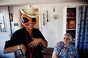 Loretta Proctor and friend, in masks.  Roswell, New Mexico.  (1947 UFO incident.)   (1997).