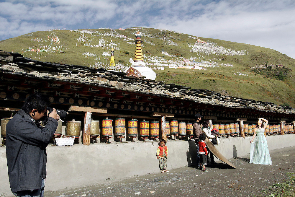 Chinese newlywed taking wedding pictures in Tibetan village, Kham
