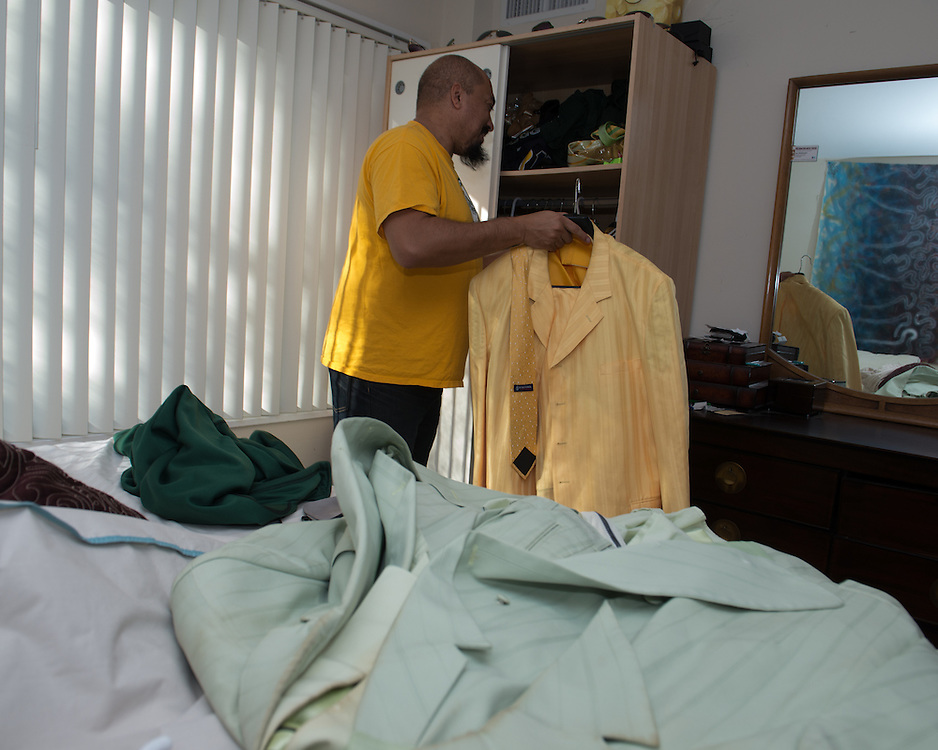 December 5, 2015 - Fairfax, VA - A day in the life of &quot;Doc Nix,&quot; aka Dr. Michael Nickens, the Director of the Athletic Bands for George Mason University. Here Doc Nix chooses an outfit for the evenings' performance.<br /> <br /> Photo by Susana Raab