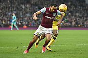Aston Villa midfielder Ahmed Elmohamady (27) runs ahead of Burton Albion midfielder Lloyd Dyer (11) for the ball during the EFL Sky Bet Championship match between Aston Villa and Burton Albion at Villa Park, Birmingham, England on 3 February 2018. Picture by Richard Holmes.