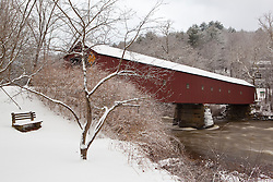 Snow falling on the West Cornwall covered bridge over the Housatonic River in West Cornwall, Connecticut.