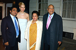 Left to right, the HON.ANGAD PAUL, his bride MICHELLE BONN and LORD & LADY PAUL leaving a reception to celebrate the wedding of Lord Paul's youngest son Angad to Michelle Bonn held at Lancaster House, London on 21st March 2005.<br />