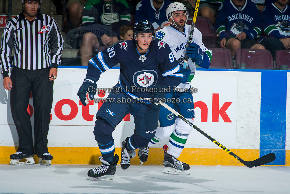 PENTICTON, CANADA - SEPTEMBER 8: Kristian Reichel #90 of Winnipeg Jets skates away from a check against the Vancouver Canucks on September 8, 2017 at the South Okanagan Event Centre in Penticton, British Columbia, Canada.  (Photo by Marissa Baecker/Shoot the Breeze)  *** Local Caption ***