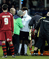 Photo: Leigh Quinnell.<br /> Luton Town v Cardiff City. Coca Cola Championship. 01/01/2007. Lutons Richard Langley is taken off after a clash of heads with Cardiffs Darren Purse.