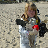 (PSUNDAY) Pt Pleasant 10/25/2003  7 year old Kate Tombs of Pt. Beach carries a variety of trash including plastic containers, clothing and a beach toy found on the beach in Pt . Pleasant in the area of Maryland Ave.  Michael J. Treola Staff Photographer......MJT