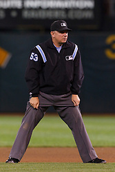 September 20, 2011; Oakland, CA, USA;  MLB umpire Greg Gibson (53) stands in the infield during the eighth inning between the Oakland Athletics and the Texas Rangers at O.co Coliseum.  Texas defeated Oakland 7-2.