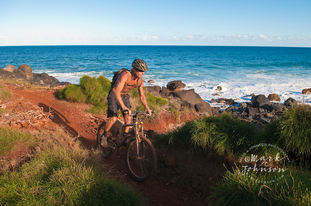 Mountain biking along the Kauai shoreline, Hawaii