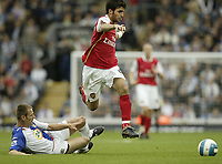 Photo: Aidan Ellis.<br /> Blackburn Rovers v Arsenal. The FA Barclays Premiership. 19/08/2007.<br /> Arsenal's Cesc Fabregas jumps the challenge from Blackburn's Andre Ooijer