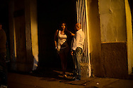 A woman and man stand outside of Club Elektra, a club where men go to pick up prostitutes in the historic district in Cartagena, Colombia.  A sex scandal erupted recently when secret service agents were found bringing prostitutes to their hotel rooms while in Cartagena preparing for President Barack Obama's arrival to the Summit of the Americas.