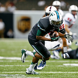 Sep 7, 2013; New Orleans, LA, USA; Tulane Green Wave wide receiver Justyn Shackleford (80) runs after a catch for a touchdon against the South Alabama Jaguars during the second quarter of a game at the Mercedes-Benz Superdome. Mandatory Credit: Derick E. Hingle-USA TODAY Sports