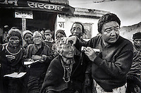 Dr Sanduk Ruit 1992 in Mustang Nepal screens patients before surgery.