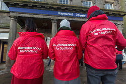 Scottish Labour launch a leaflet promoting their rail fare freeze policy, as well as a further breakdown of the impact of a rail fare freeze.  The leaflet is in the style of a rail ticket.  <br /> <br /> Pictured: Scottish Labour activists handing out the new leaflet
