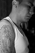 Tattoo of a man attending the annual celebration of Our Holy Mother of Guadalupe in La Villa, Mexico City.