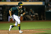 Oakland Athletics center fielder Jaycob Brugman (38) runs to first base on a hit against the San Francisco Giants at Oakland Coliseum in Oakland, California, on August 1, 2017. (Stan Olszewski/Special to S.F. Examiner)