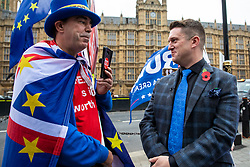 © Licensed to London News Pictures. 06/11/2018. London, UK. Right-wing activist Tommy Robinson (R) speaks with an anti-Brexit activist (L) in Westminster. Photo credit: Rob Pinney/LNP