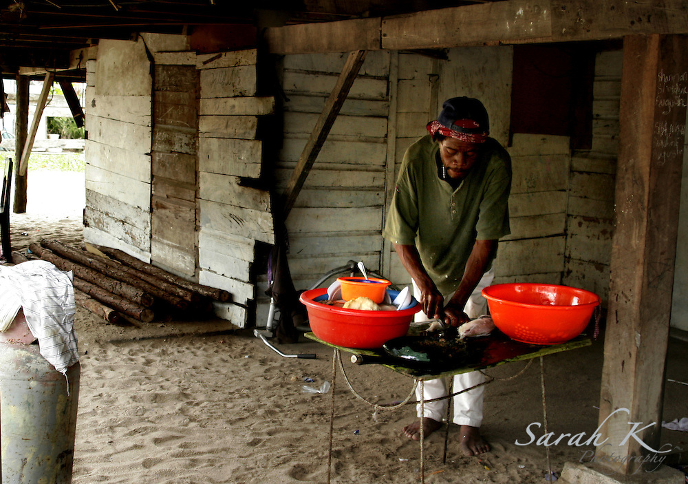 Drummer Peter Magdaleno filets a fish underneath a friend's house, he prefers to buy fish rather than catch them.