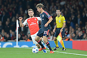 Arsenal defender Nacho Monreal attempts to tackle Bayern Munich striker Thomas Muller during the Champions League  Group F match between Arsenal and Bayern Munich at the Emirates Stadium, London, England on 20 October 2015. Photo by Alan Franklin.
