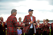 Matt Kuchar, center, received the plaid jacket from Jack Jones, vice president and general manager of Boeing South Carolina, after winning the final round of the RBC Heritage golf tournament in Hilton Head Island, S.C., Sunday, April 20, 2014. Matt Kuchar won the tournament with 11-under par. (AP Photo/Stephen B. Morton)