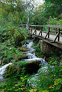 Bridge and walkway over waterfall, Krka National Park, Croatia