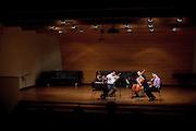 Amelia Thornton, Bobby Luan, Tonio Meade and Tim Cuffman perform a string quartet recital at Ohio University's Robert Glidden Hall in Athens, Ohio on Sunday, December 2, 2012. Photo by Chris Franz