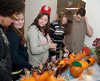 Alternative School students Reggie Pygum, Jessica Roy, Maggie Hughes, Tim Eichstaedt and Reis Bradford were on hand to judge costumes and the pumpkins decorated by seniors gathered at the Laconia Senior Center on Thursday for their Halloween festivities.   (Karen Bobotas/for the Laconia Daily Sun)