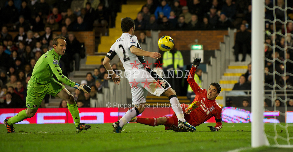 LONDON, ENGLAND - Monday, December 5, 2011: Liverpool's Luis Alberto Suarez Diaz scores past Fulham's goalkeeper Mark Schwarzer but the goal is disallowed during the Premiership match at Craven Cottage. (Pic by David Rawcliffe/Propaganda)