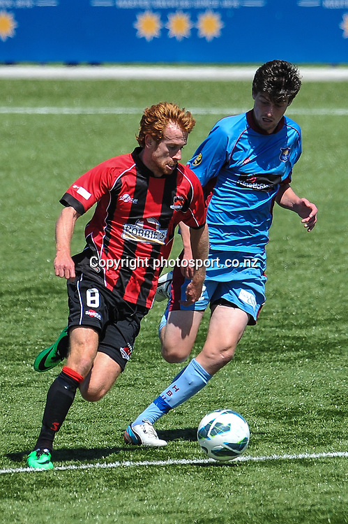 Aaron CLAPHAM of Canterbury United and Harry EDGE in action in the ASB Premiership, Canterbury v Hawkes Bay, 16 February 2014. Photo:John Davidson/photosport.co.nz
