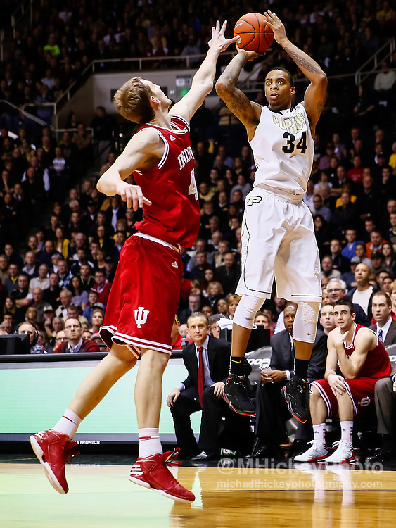 WEST LAFAYETTE, IN - JANUARY 30: Jacob Lawson #34 of the Purdue Boilermakers shoots the ball against Cody Zeller #40 of the Indiana Hoosiers at Mackey Arena on January 30, 2013 in West Lafayette, Indiana. Indiana defeated Purdue 97-60. (Photo by Michael Hickey/Getty Images) *** Local Caption *** Jacob Lawson; Cody Zeller