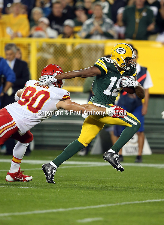 Green Bay Packers wide receiver Randall Cobb (18) pulls away from Kansas City Chiefs inside linebacker Josh Mauga (90) as he races for the end zone as he catches a second quarter touchdown pass nullified by penalty during the 2015 NFL week 3 regular season football game against the Kansas City Chiefs on Monday, Sept. 28, 2015 in Green Bay, Wis. The Packers won the game 38-28. (©Paul Anthony Spinelli)
