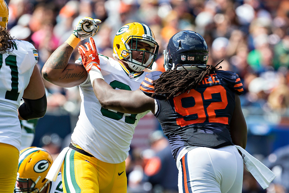 CHICAGO, IL - SEPTEMBER 13:  Andrew Quarrels #81 of the Green Bay Packers blocks Pernell McPhee #92 of the Chicago Bears at Soldier Field on September 13, 2015 in Chicago, Illinois.  The Packers defeated the Bears 31-23.  (Photo by Wesley Hitt/Getty Images) *** Local Caption *** Andrew Quarrels; Pernell McPhee