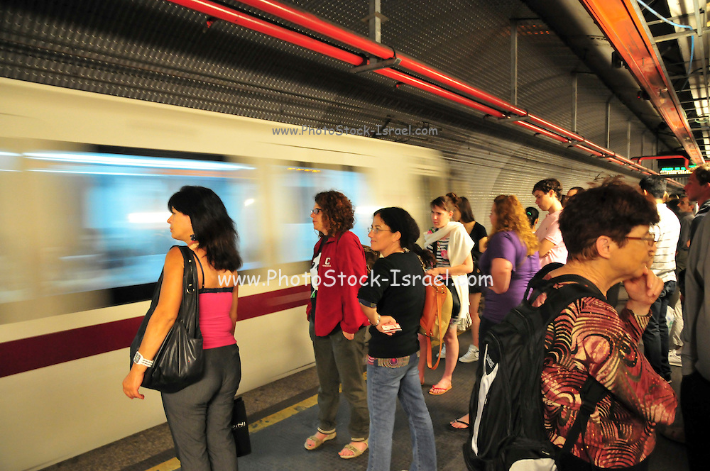 Rome, Italy Passengers at an undeground metro station train passes with motion blur
