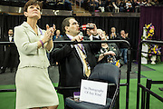 "New York, NY - 16 February 2016. Westminster Kennel Club officials during the Junior Division competition at the 140th Westminster Kennel Club Dog show in Madison Square Garden. The sign on the chair reads ""No Photography of Any Kind"". and prohbits photography from the press risers of dogs waiting to enter the ring."