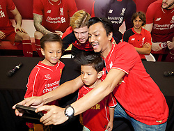 KUALA LUMPUR, MALAYSIA - Wednesday, July 22, 2015: Liverpool's Alberto Moreno takes a selfie with supporters during an event at the Mid Valley Mega Mall on day ten of the club's preseason tour. (Pic by David Rawcliffe/Propaganda)