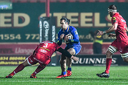 Leinster's James Lowe is tackled by Scarlets' Werner Kruger<br /> <br /> Photographer Craig Thomas/Replay Images<br /> <br /> Guinness PRO14 Round 17 - Scarlets v Leinster - Friday 9th March 2018 - Parc Y Scarlets - Llanelli<br /> <br /> World Copyright © Replay Images . All rights reserved. info@replayimages.co.uk - http://replayimages.co.uk
