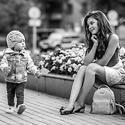Young girl toddler walking confidently, passing her older sister.