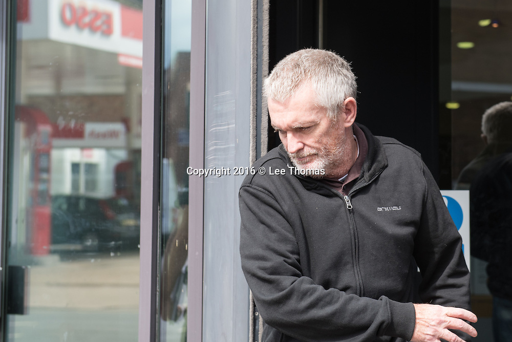 """Worcester Magistrates' Court, Castle Street, Worcester, July 8th 2016.  Paul Grange, aged 50, arrives at Worcester Magistrates' Court after allegedly wearing a t-shirt with an offensive statement about the Hillsborough tragedy where 96 Liverpool fans died. The black t-shirt allegedly stated the tragedy was """"God's way"""" of aiding a pest control company. A photograph of the man allegedly sitting in the pub garden of the Brewers Arms in Comer Road, St John's, Worcester, sparked outrage worldwide after it was posted across social media sites. Pictured:  Paul Grange leaves Worcester Magistrates' Court. // Lee Thomas, Flat 47a Park East Building, Bow Quarter, London, E3 2UT. Tel. 07784142973. Email: leepthomas@gmail.com. www.leept.co.uk (0000635435)"""